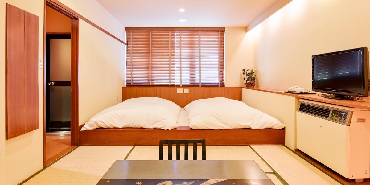 源泉内風呂付特別客室 花かんざしの間(ベッド)
